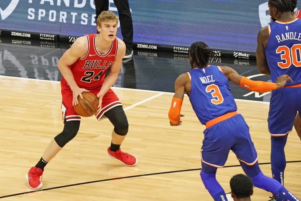 Feb 3, 2021; Chicago, Illinois, USA;  Chicago Bulls forward Lauri Markkanen (24) dribbles the ball against New York Knicks center Nerlens Noel (3) during the first quarter at the United Center. Mandatory Credit: Mike Dinovo-USA TODAY Sports