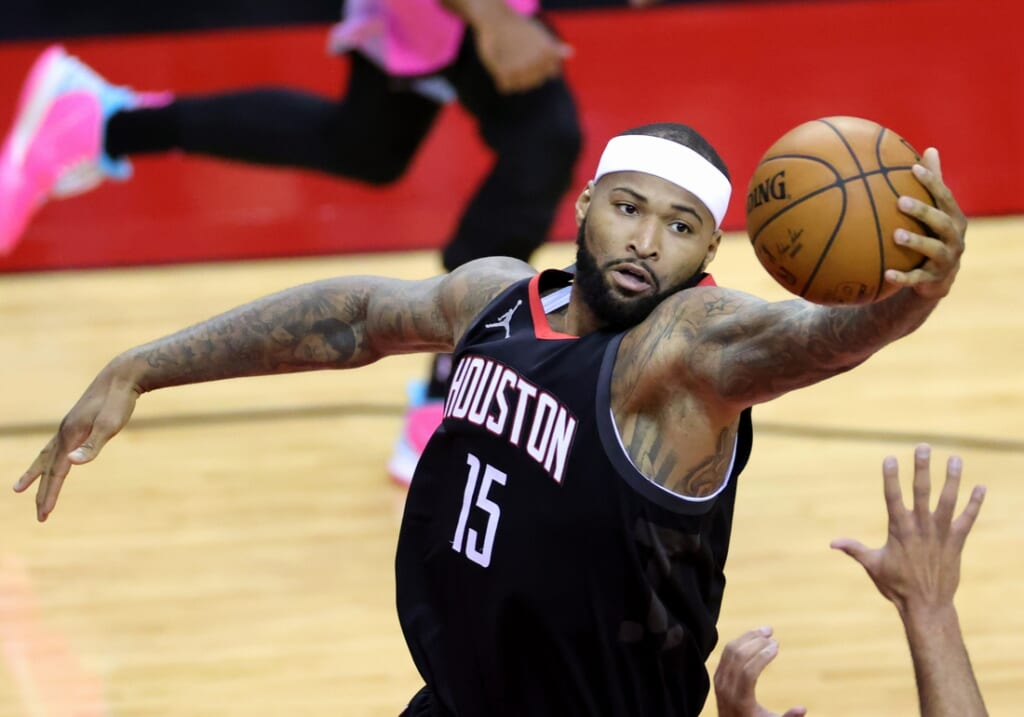 Feb 11, 2021; Houston, Texas, USA; Houston Rockets center DeMarcus Cousins (15) reaches for a rebound during the second quarter against the Miami Heat at Toyota Center. Mandatory Credit:  Carmen Mandato/Pool Photos-USA TODAY Sports