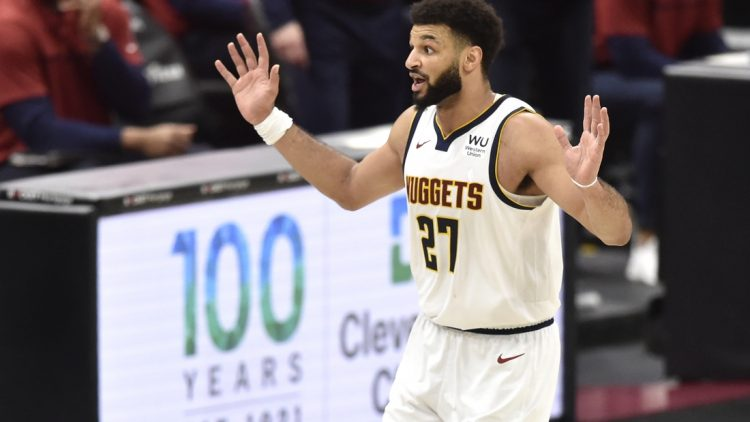 Feb 19, 2021; Cleveland, Ohio, USA; Denver Nuggets guard Jamal Murray (27) reacts after making a basket in the fourth quarter against the Cleveland Cavaliers at Rocket Mortgage FieldHouse. Mandatory Credit: David Richard-USA TODAY Sports