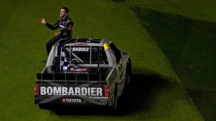 Feb 19, 2021; Daytona Beach, FL, USA; NASCAR Truck Series driver Ben Rhodes (99) sits on his truck after celebrating his win in the Brake Best Select 159 at the Daytona International Speedway Road Course. Mandatory Credit: Jasen Vinlove-USA TODAY Sports