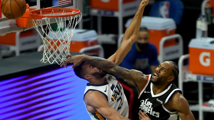 Feb 19, 2021; Los Angeles, California, USA;  Los Angeles Clippers forward Kawhi Leonard (2) is charged with an offensive foul as he goes up for a dunk over Utah Jazz center Rudy Gobert (27) in the second half of the game at Staples Center. Mandatory Credit: Jayne Kamin-Oncea-USA TODAY Sports