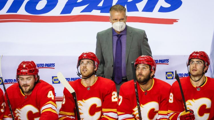 Feb 19, 2021; Calgary, Alberta, CAN; Calgary Flames head coach Geoff Ward on his bench against the Edmonton Oilers during the second period at Scotiabank Saddledome. Mandatory Credit: Sergei Belski-USA TODAY Sports