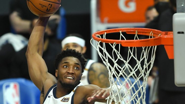 Feb 19, 2021; Los Angeles, California, USA; Utah Jazz guard Donovan Mitchell (45) goes up for a dunk in the second half of the game against the Los Angeles Clippers at Staples Center. Mandatory Credit: Jayne Kamin-Oncea-USA TODAY Sports