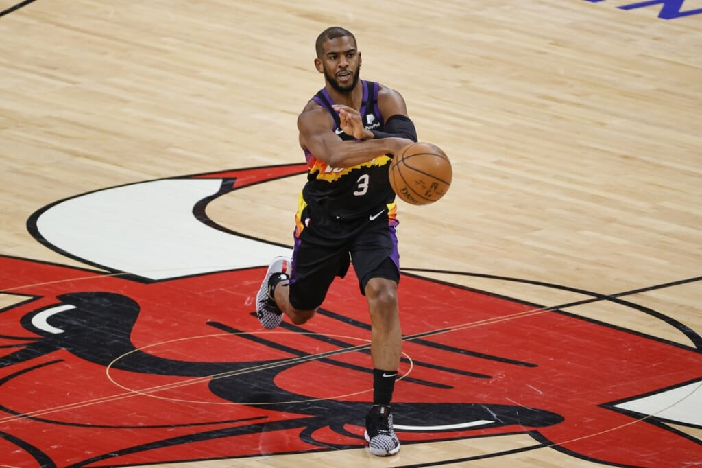 Feb 26, 2021; Chicago, Illinois, USA; Phoenix Suns guard Chris Paul (3) passes the ball against the Chicago Bulls during the first half of an NBA game at United Center. Mandatory Credit: Kamil Krzaczynski-USA TODAY Sports