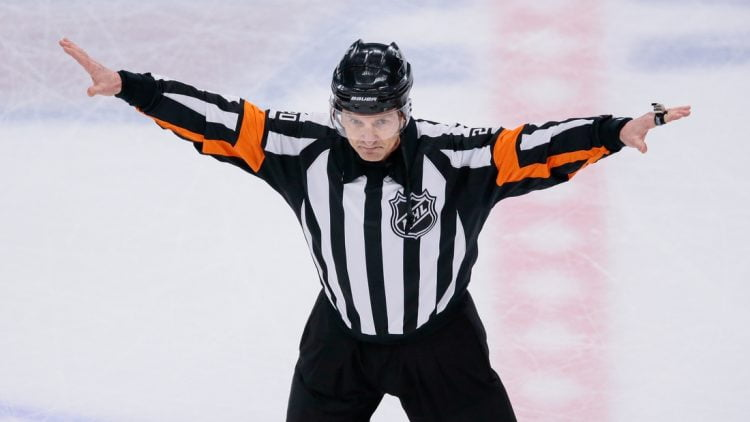 Apr 22, 2018; Denver, CO, USA; Referee Tim Peel (20) waves off a Colorado Avalanche goal in the second period against the Nashville Predators in game six of the first round of the 2018 Stanley Cup Playoffs at the Pepsi Center. Mandatory Credit: Isaiah J. Downing-USA TODAY Sports