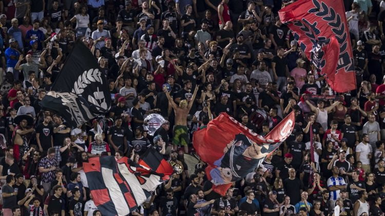 Aug 21, 2019; Washington, D.C., USA; D.C. United fans celebrate against the New York Red Bulls during the first half at Audi Field. Mandatory Credit: Scott Taetsch-USA TODAY Sports