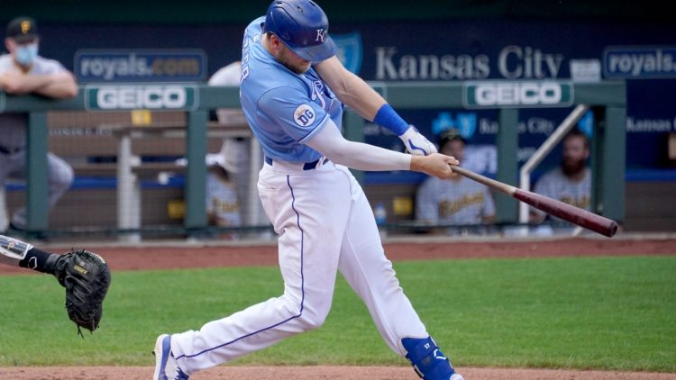 Sep 13, 2020; Kansas City, Missouri, USA; Kansas City Royals first baseman Hunter Dozier (17) connects for a solo home run in the sixth inning against the Pittsburgh Pirates at Kauffman Stadium. Mandatory Credit: Denny Medley-USA TODAY Sports