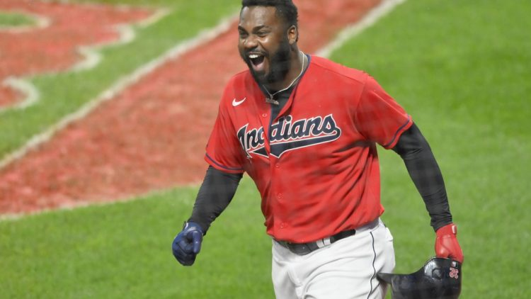 Sep 30, 2020; Cleveland, Ohio, USA; Cleveland Indians right fielder Franmil Reyes (32) reacts after scoring in the first inning against the New York Yankees at Progressive Field. Mandatory Credit: David Richard-USA TODAY Sports