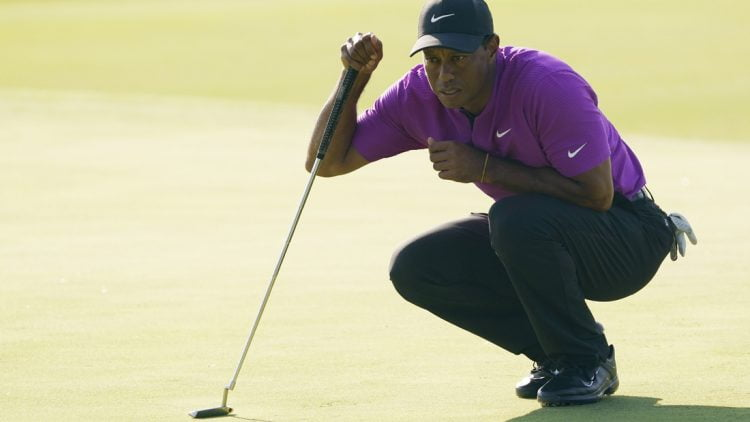 Nov 14, 2020; Augusta, Georgia, USA; Tiger Woods lines up his putt on the 17th green during the third round of The Masters golf tournament at Augusta National GC. Mandatory Credit: Michael Madrid-USA TODAY Sports