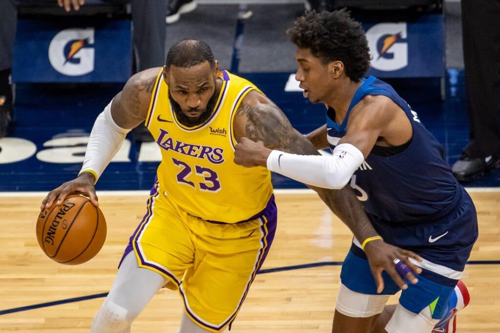 Feb 16, 2021; Minneapolis, Minnesota, USA; Los Angeles Lakers forward LeBron James (23) dribbles the ball against Minnesota Timberwolves forward Jaden McDaniels (3) in the second half at Target Center. Mandatory Credit: Jesse Johnson-USA TODAY Sports