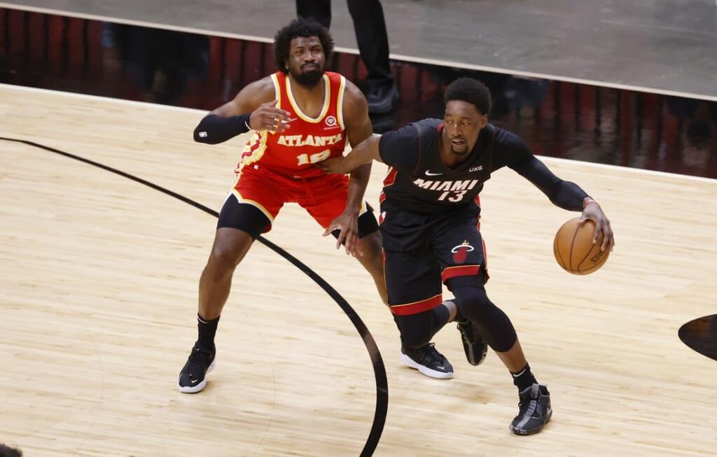 Feb 28, 2021; Miami, Florida, USA;   Atlanta Hawks forward Solomon Hill (18) defends Miami Heat center Bam Adebayo (13) during the first half at American Airlines Arena. Mandatory Credit: Rhona Wise-USA TODAY Sports