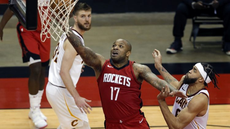 Mar 1, 2021; Houston, Texas, USA; Houston Rockets forward P.J. Tucker (17) puts up a shot between Cleveland Cavaliers forward Dean Wade (left) and center JaVale McGee (right) during the second half at the Toyota Center. Mandatory Credit:  Michael Wyke-POOL PHOTOS-USA TODAY Sports