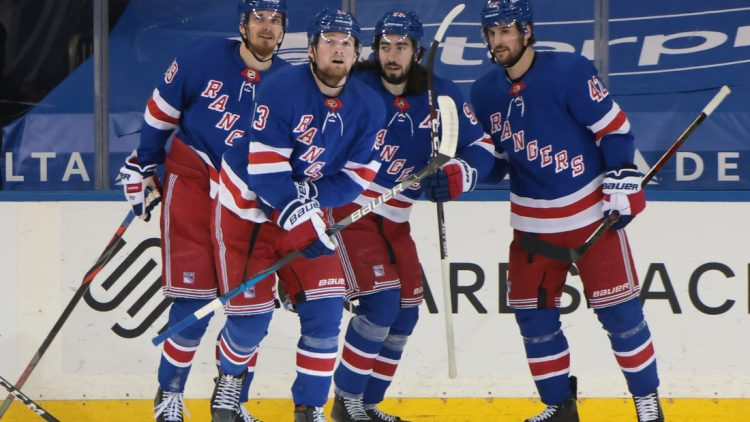 Mar 2, 2021; New York, New York, USA;  New York Rangers left wing Alexis Lafreniere (13) (second from left) celebrates after scoring a goal against the Buffalo Sabres at 2:13 of the first period at Madison Square Garden. Mandatory Credit: Bruce Bennett-POOL PHOTOS-USA TODAY Sports