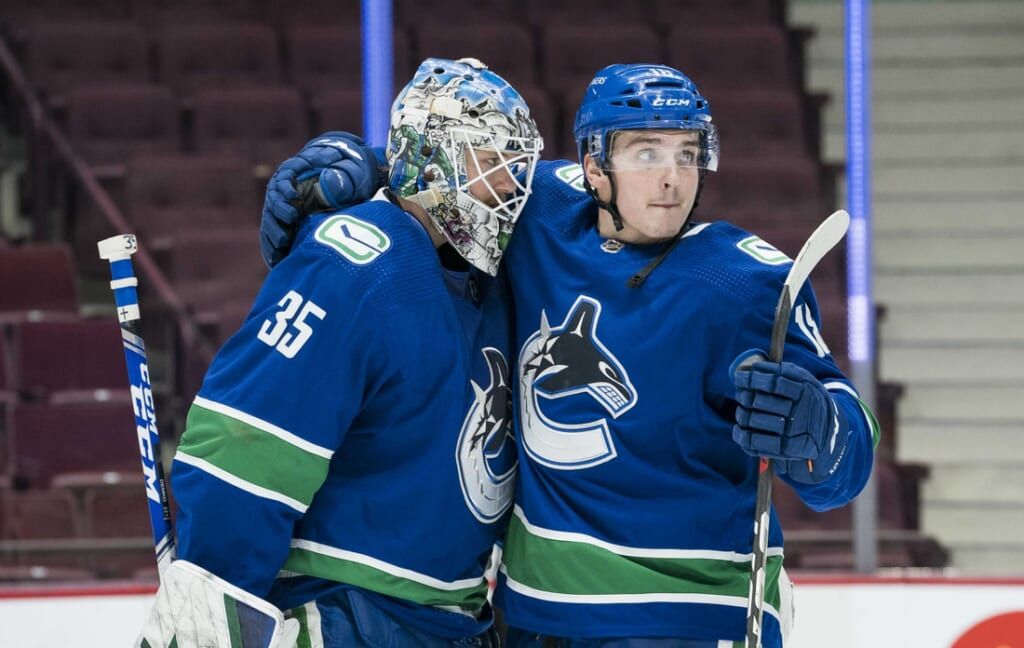 Mar 4, 2021; Vancouver, British Columbia, CAN; Vancouver Canucks goalie Thatcher Demko (35) and forward Jake Virtanen (18) celebrate their victory against the Toronto Maple Leafs in the third period at Rogers Arena. Canucks won 3-1. Mandatory Credit: Bob Frid-USA TODAY Sports