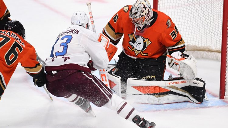 Mar 5, 2021; Denver, Colorado, USA; Colorado Avalanche right wing Valeri Nichushkin (13) scores against Anaheim Ducks goaltender John Gibson (36) in overtime at Ball Arena. Mandatory Credit: Ron Chenoy-USA TODAY Sports