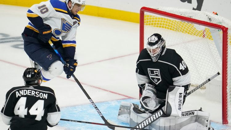 Mar 5, 2021; Los Angeles, California, USA; Los Angeles Kings goaltender Calvin Petersen (40) makes a save as St. Louis Blues center Brayden Schenn (10) jumps out of the way during the third period at Staples Center. Mandatory Credit: Robert Hanashiro-USA TODAY Sports
