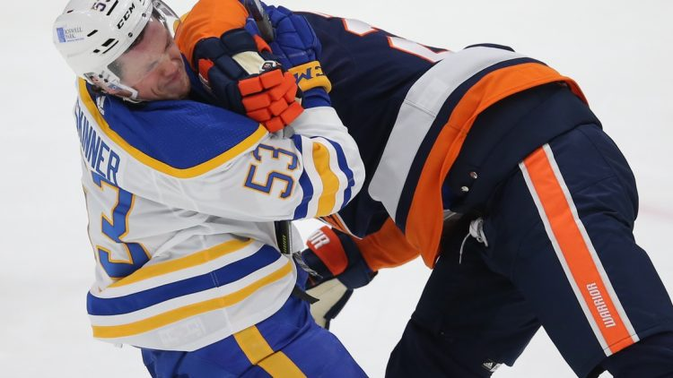 Mar 6, 2021; Uniondale, New York, USA; Buffalo Sabres left wing Jeff Skinner (53) is hit by New York Islanders defenseman Scott Mayfield (24) during the second period at Nassau Veterans Memorial Coliseum. Mandatory Credit: Brad Penner-USA TODAY Sports