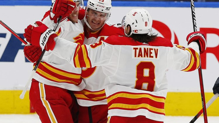 Mar 6, 2021; Edmonton, Alberta, CAN; Calgary Flames defensemen Noah Hanifin (55) celebrates after a third period goal against the Edmonton Oilers at Rogers Place. Mandatory Credit: Perry Nelson-USA TODAY Sports