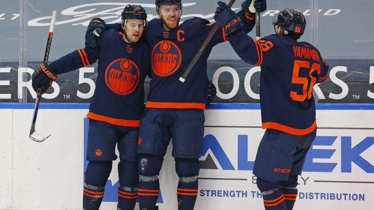 Mar 6, 2021; Edmonton, Alberta, CAN; Edmonton Oilers forward Connor McDavid (97) celebrates after scoring the game winning goal against the Calgary Flames in the third period at Rogers Place. Mandatory Credit: Perry Nelson-USA TODAY Sports