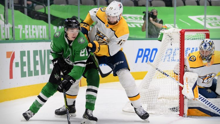Mar 7, 2021; Dallas, Texas, USA; Nashville Predators defenseman Ben Harpur (17) defends against Dallas Stars left wing Jason Robertson (21) during the second period at the American Airlines Center. Mandatory Credit: Jerome Miron-USA TODAY Sports