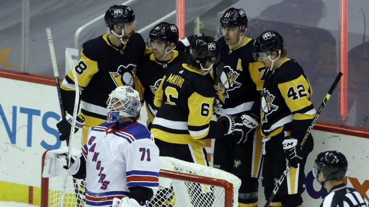 Mar 7, 2021; Pittsburgh, Pennsylvania, USA;  The Pittsburgh Penguins celebrate a goal by center Evgeni Malkin (71) against New York Rangers goaltender Keith Kinkaid (71) during the third period at PPG Paints Arena. The Penguins won 5-1. Mandatory Credit: Charles LeClaire-USA TODAY Sports