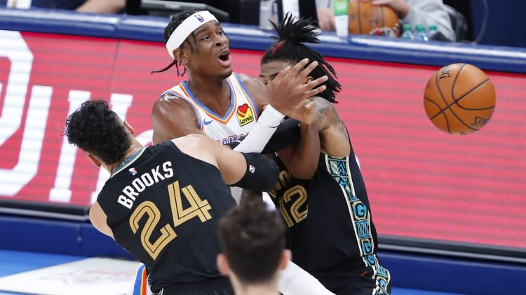 Mar 14, 2021; Oklahoma City, Oklahoma, USA; Oklahoma City Thunder guard Shai Gilgeous-Alexander (C) is fouled while defended by Memphis Grizzlies guard Dillon Brooks (24) and guard Ja Morant (12) during the second half at Chesapeake Energy Arena. Mandatory Credit: Alonzo Adams-USA TODAY Sports