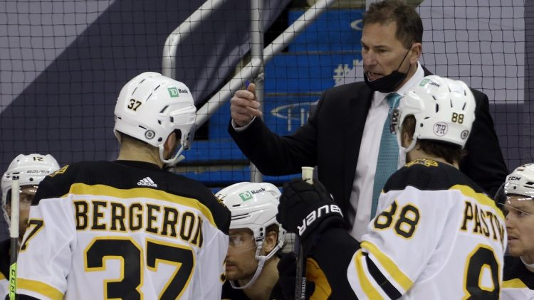 Mar 16, 2021; Pittsburgh, Pennsylvania, USA; Boston Bruins had coach Bruce Cassidy (rear) talks to center Patrice Bergeron (37) and right wing David Pastrnak (88) during a time-out in the third period against the Pittsburgh Penguins at PPG Paints Arena.  Boston won 2-1. Mandatory Credit: Charles LeClaire-USA TODAY Sports