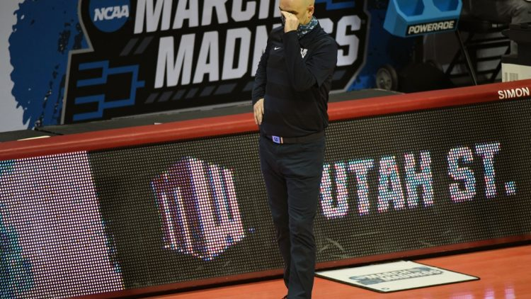 Mar 19, 2021; Bloomington, Indiana, USA; Utah State Aggies head coach Craig Smith reacts during the 65-53 loss in the first round of the 2021 NCAA Tournament at Simon Skjodt Assembly Hall. Mandatory Credit: Robert Goddin-USA TODAY Sports