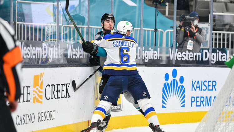 Mar 19, 2021; San Jose, California, USA; St. Louis Blues defenseman Marco Scandella (6) pins San Jose Sharks right wing Timo Meier (28) to the boards in the first period at SAP Center at San Jose. Mandatory Credit: Chris Brown-USA TODAY Sports