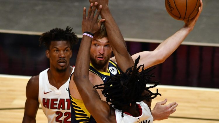 Mar 21, 2021; Miami, Florida, USA; Indiana Pacers forward Domantas Sabonis (11) looks to pass as Miami Heat forward Jimmy Butler (22) and forward Precious Achiuwa (5) defend on the play in the first quarter at American Airlines Arena. Mandatory Credit: Jim Rassol-USA TODAY Sports
