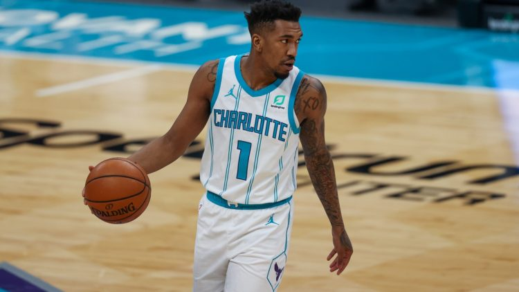 Mar 15, 2021; Charlotte, North Carolina, USA; Charlotte Hornets guard Malik Monk (1) brings the ball up court against the Sacramento Kings during the second half at Spectrum Center. The Charlotte Hornets won 122-116. Mandatory Credit: Nell Redmond-USA TODAY Sports