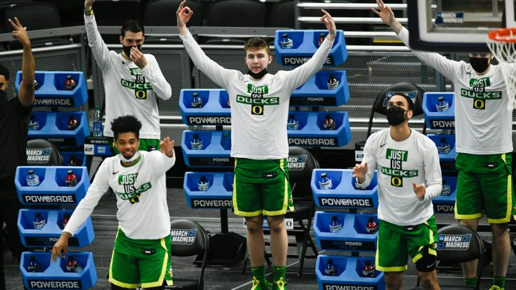 The Oregon Ducks react to guard Will Richardson (0) scoring a three-pointer during their game against the Iowa Hawkeyes in the second round of the 2021 NCAA Tournament on Monday, March 22, 2021, at Bankers Life Fieldhouse in Indianapolis, Ind. Mandatory Credit: Sam Owens/IndyStar via USA TODAY Sports
