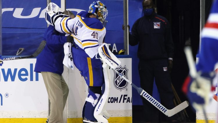 Mar 22, 2021; New York, New York, USA;  Buffalo Sabres goaltender Carter Hutton (40)  is assisted off the ice following a first period injury against the New York Rangers at Madison Square Garden. Mandatory Credit: Bruce Bennett/POOL PHOTOS-USA TODAY Sports