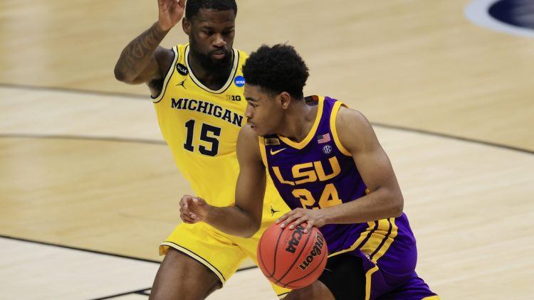 Mar 22, 2021; Indianapolis, Indiana, USA; Louisiana State Tigers guard Cameron Thomas (24) drives to the basket while Michigan Wolverines guard Chaundee Brown (15) defends during the first half in the second round of the 2021 NCAA Tournament at Lucas Oil Stadium. Mandatory Credit: Aaron Doster-USA TODAY Sports