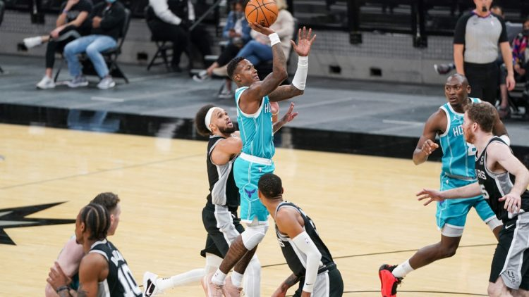 Mar 22, 2021; San Antonio, Texas, USA;  Charlotte Hornets guard Terry Rozier (3) shoots the ball against the San Antonio Spurs in the second half at the AT&T Center. Mandatory Credit: Daniel Dunn-USA TODAY Sports