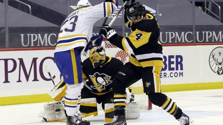 Mar 25, 2021; Pittsburgh, Pennsylvania, USA; Pittsburgh Penguins goaltender Casey DeSmith (1) makes a save as Pens defenseman Cody Ceci (4) battles Buffalo Sabres center Sam Reinhart (23) during the first period at PPG Paints Arena. Mandatory Credit: Charles LeClaire-USA TODAY Sports