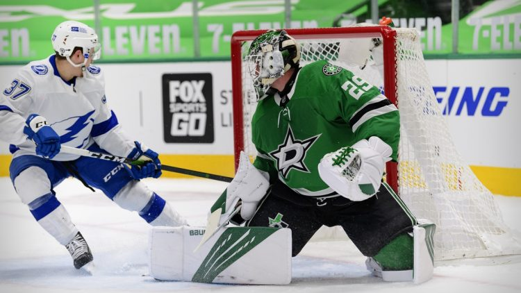 Mar 25, 2021; Dallas, Texas, USA; Dallas Stars goaltender Jake Oettinger (29) turns away a shot by Tampa Bay Lightning center Yanni Gourde (37) during the first period at the American Airlines Center. Mandatory Credit: Jerome Miron-USA TODAY Sports