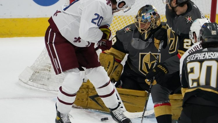 Mar 25, 2021; Denver, Colorado, USA; Colorado Avalanche left wing Brandon Saad (20) attempts a shot past Vegas Golden Knights goaltender Marc-Andre Fleury (29) in the first period at Ball Arena. Mandatory Credit: Ron Chenoy-USA TODAY Sports