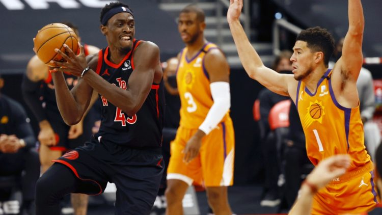 Mar 26, 2021; Tampa, Florida, USA; Toronto Raptors forward Pascal Siakam (43) drives to the basket as Phoenix Suns guard Devin Booker (1) defends during the first half at Amalie Arena. Mandatory Credit: Kim Klement-USA TODAY Sports