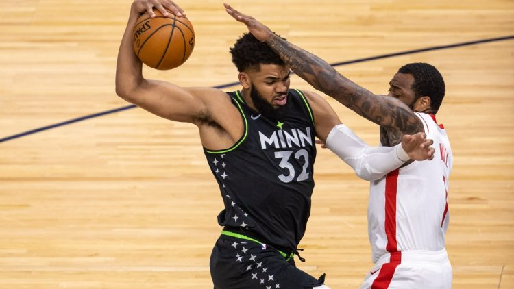 Mar 26, 2021; Minneapolis, Minnesota, USA; Minnesota Timberwolves center Karl-Anthony Towns (32) drives to the basket as Houston Rockets guard John Wall (1) plays defense in the first half at Target Center. Mandatory Credit: Jesse Johnson-USA TODAY Sports