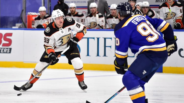 Mar 26, 2021; St. Louis, Missouri, USA;  Anaheim Ducks right wing Jakob Silfverberg (33) handles the puck as St. Louis Blues center Ryan O'Reilly (90) defends during the second period at Enterprise Center. Mandatory Credit: Jeff Curry-USA TODAY Sports