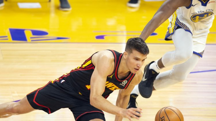 Mar 26, 2021; San Francisco, California, USA; Atlanta Hawks guard Bogdan Bogdanovic (13) trips and loses the dribble in front of Golden State Warriors center James Wiseman (33) during the first quarter of an NBA basketball game at Chase Center. Mandatory Credit: D. Ross Cameron-USA TODAY Sports