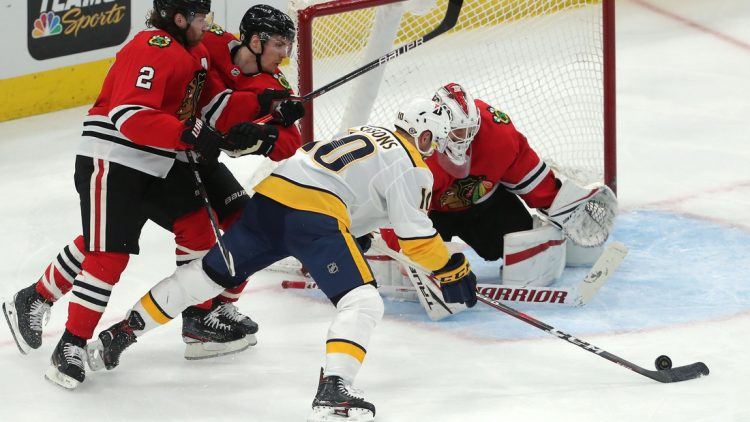 Mar 27, 2021; Chicago, Illinois, USA; Nashville Predators center Colton Sissons (10) moves in on Chicago Blackhawks goaltender Kevin Lankinen (32) during the second period at the United Center. Mandatory Credit: Dennis Wierzbicki-USA TODAY Sports