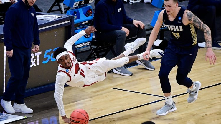 Mar 27, 2021; Indianapolis, Indiana, USA; Arkansas Razorbacks guard Jalen Tate (11) dives for a loose ball during the second half against Oral Roberts Golden Eagles in the Sweet Sixteen of the 2021 NCAA Tournament at Bankers Life Fieldhouse. Mandatory Credit: Marc Lebryk-USA TODAY Sports