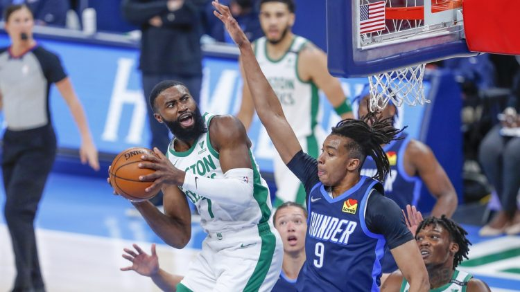 Mar 27, 2021; Oklahoma City, Oklahoma, USA; Boston Celtics guard Jaylen Brown (7) works to shoot as he is defended by Oklahoma City Thunder center Moses Brown (9) during the first quarter at Chesapeake Energy Arena. Mandatory Credit: Alonzo Adams-USA TODAY Sports