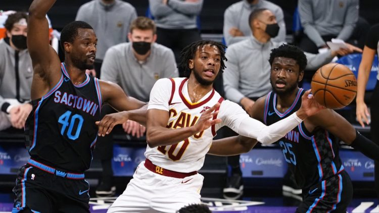 Mar 27, 2021; Sacramento, California, USA; Cleveland Cavaliers guard Darius Garland (10) passes the ball against Sacramento Kings forward Harrison Barners (40) and forward Chimezie Metu (25) during the first quarter at Golden 1 Center. Mandatory Credit: Kelley L Cox-USA TODAY Sports