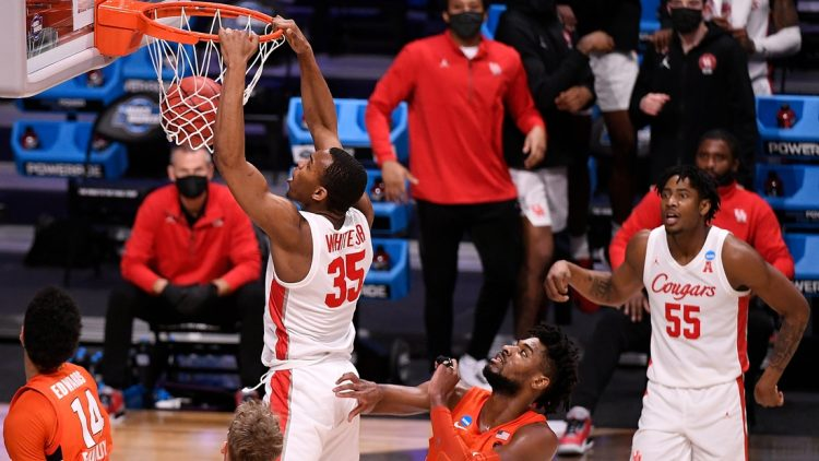 Mar 27, 2021; Indianapolis, Indiana, USA; Houston Cougars forward Fabian White Jr. (35) dunks during the second half against the Syracuse Orange in the Sweet Sixteen of the 2021 NCAA Tournament at Hinkle Fieldhouse. Mandatory Credit: Doug McSchooler-USA TODAY Sports