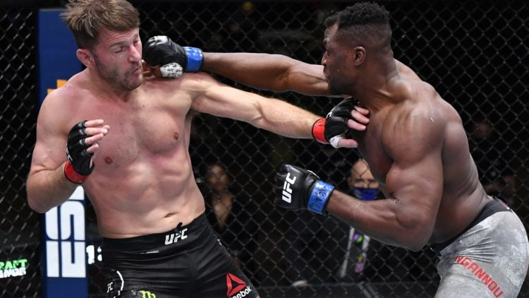 Mar 27, 2021; Las Vegas, NV, USA;   Francis Ngannou of Cameroon punches Stipe Miocic in their UFC heavyweight championship fight during the UFC 260 event at UFC APEX on March 27, 2021 in Las Vegas, Nevada.   Mandatory Credit: Jeff Bottari/Handout Photo via USA TODAY Sports