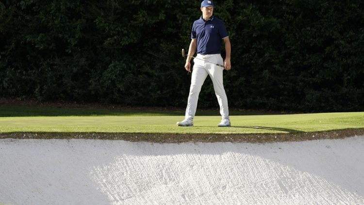 Nov 10, 2020; Augusta, Georgia, USA; Jordan Spieth surveys the bunker at the fourth green during a practice round for The Masters golf tournament at Augusta National GC. Mandatory Credit: Rob Schumacher-USA TODAY Sports