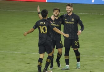 Dec 22, 2020; Orlando, Florida, USA; Los Angeles FC defender Tristan Blackmon (27) and forward Carlos Vela (10) congratulate forward Diego Rossi (9) on a goal against Tigres during the second half of the match at the 2020 SCCL final at Exploria Stadium. Mandatory Credit: Reinhold Matay-USA TODAY Sports